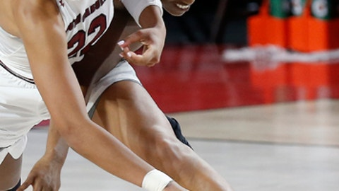 South Carolina forward A'ja Wilson (22) and Georgia guard Maya Caldwell (11) compete for posssession of the ball during an NCAA college basketball game Thursday, Feb. 15, 2018, in Athens, Ga. (Joshua L. Jones/Athens Banner-Herald via AP)