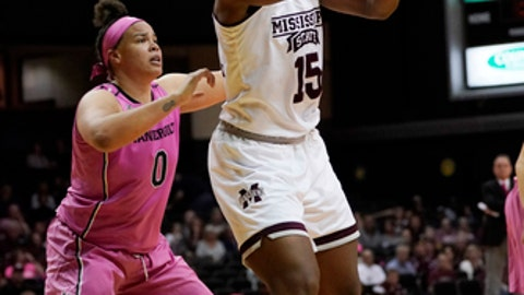 Mississippi State center Teaira McCowan (15) passes as Vanderbilt forward Kayla Overbeck (0) defends in the first half of an NCAA college basketball game Thursday, Feb. 15, 2018, in Nashville, Tenn. (AP Photo/Sanford Myers)