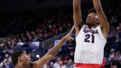 Gonzaga forward Rui Hachimura (21) shoots over Loyola Marymount forward Zafir Williams (1) during the first half of an NCAA college basketball game in Spokane, Wash., Thursday, Feb. 15, 2018. (AP Photo/Young Kwak)