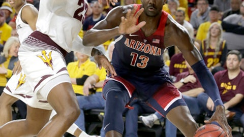 Arizona forward Deandre Ayton (13) drives on Arizona State forward Romello White during the first half during an NCAA college basketball game Thursday, Feb. 15, 2018, in Tempe, Ariz. (AP Photo/Rick Scuteri)