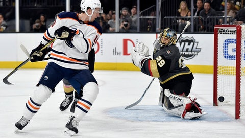 Vegas Golden Knights goalie Marc-Andre Fleury (29) deflects a shot by Edmonton Oilers center Ryan Strome during the third period of an NHL hockey game Thursday, Feb. 15, 2018, in Las Vegas. The Golden Knights won 4-1. (AP Photo/David Becker)