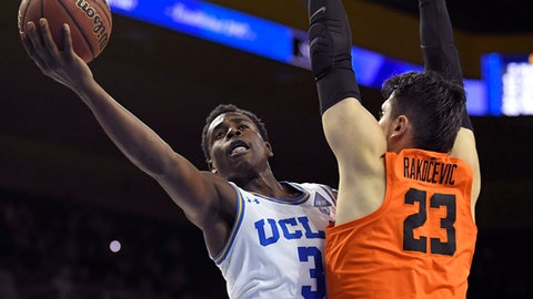 UCLA guard Aaron Holiday shoots as Oregon State center Gligorije Rakocevic defends during the second half of an NCAA college basketball game Thursday, Feb. 15, 2018, in Los Angeles. UCLA won 75-68. (AP Photo/Mark J. Terrill)