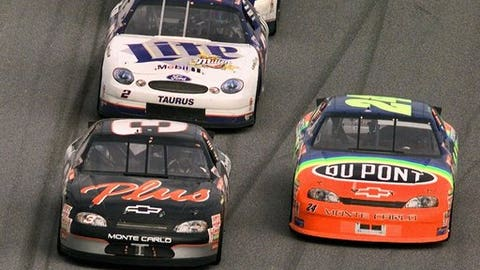 FILE - IN this Feb. 15, 1998, file photo, Dale Earnhardt, front left, takes the lead from Jeff Gordon, right, for the final time as he drives to his first-ever win in the NASCAR Daytona 500 auto race at Daytona International Speedwayin Daytona Beach, Fla. Rusty Wallace is behind Earnhardt. (AP Photo/Phil Coale, File)