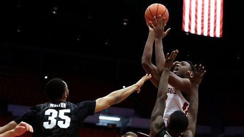 Washington State forward Robert Franks shoots above Colorado forward Dallas Walton (35) and guard McKinley Wright IV, lower right, during the second half of an NCAA college basketball game Thursday, Feb. 15, 2018, in Pullman, Wash. Washington State won 73-69. (AP Photo/Ted S. Warren)