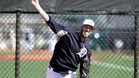 Detroit Tigers pitcher Mike Fiers throws in the bullpen at baseball spring training camp, Friday, Feb. 16, 2018, in Lakeland, Fla. (AP Photo/Lynne Sladky)