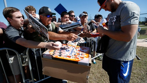 Houston Astros George Springer signs autographs for fans after  spring baseball training,  Friday, Feb. 16, 2018, in West Palm Beach, Fla.  (Karen Warren/Houston Chronicle via AP)