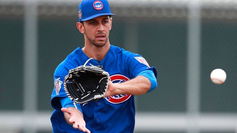 Chicago Cubs pitcher Steve Cishek participates in a drill at the team's spring training baseball facility Friday, Feb. 16, 2018, in Mesa, Ariz. (AP Photo/Carlos Osorio)