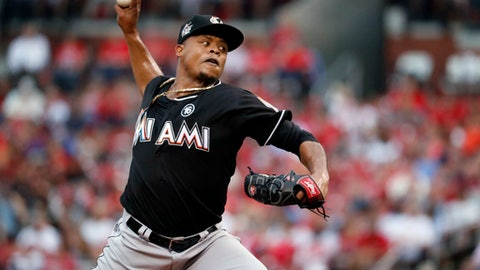 FILE - In this July 5, 2017, file photo, Miami Marlins starting pitcher Edinson Volquez throws during the first inning of the team's baseball game against the St. Louis Cardinals in St. Louis. Volquez has agreed to a minor league contract with the Texas Rangers, returning to his original team with a chance to be a candidate for the rotation in 2019. The 34-year-old Volquez will not pitch this season while recovering from ligament reconstruction surgery on his right elbow last August. (AP Photo/Jeff Roberson, File)