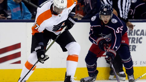 Philadelphia Flyers forward Wayne Simmonds, left, works against Columbus Blue Jackets defenseman Markus Nutivaara, of Finland, during the second period of an NHL hockey game in Columbus, Ohio, Friday, Feb. 16, 2018. (AP Photo/Paul Vernon)