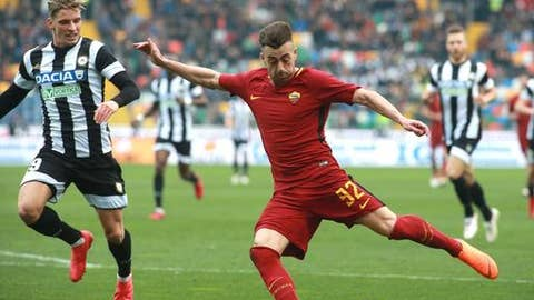 Udinese's Jens Stryger Larsen, left, and Roma's Stephan El Shaarawy, vie for the ball during the Italian Serie A soccer match between Udinese and Roma at the Friuli stadium in Udine, Italy, Saturday, Feb. 17, 2018. (Stefano Lancia/ANSA via AP)
