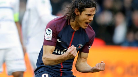 PSG's Edinson Cavani celebrates his goal during the French League One soccer match between Paris Saint Germain and Strasbourg, at the Parc des Princes stadium in Paris, France, Saturday, Feb. 17, 2018. (AP Photo/Francois Mori)