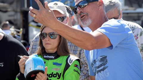 A fan takes a selfie with Danica Patrick, left, before practice for the NASCAR Daytona 500 Cup Series auto race at Daytona International Speedway in Daytona Beach, Fla., Saturday, Feb. 17, 2018. Patrick has one last chance at a win in NASCAR, on its biggest stage, at the Daytona 500. She will run only that event, then focus on the Indianapolis 500 before she retires as a race car driver. (AP Photo/Phelan M. Ebenhack)
