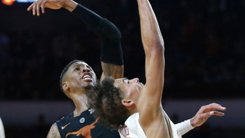Texas guard Kerwin Roach II (12) knocks the ball away as Oklahoma guard Trae Young, right, shoots in the second half of an NCAA college basketball game in Norman, Okla., Saturday, Feb. 17, 2018. (AP Photo/Sue Ogrocki)