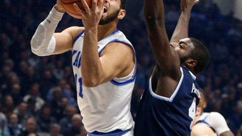 Xavier forward Kerem Kanter, left, puts up a shot against Villanova forward Eric Paschall, right, during the first half of an NCAA college basketball game, Saturday Feb. 17, 2018, in Cincinnati. (AP Photo/Gary Landers)