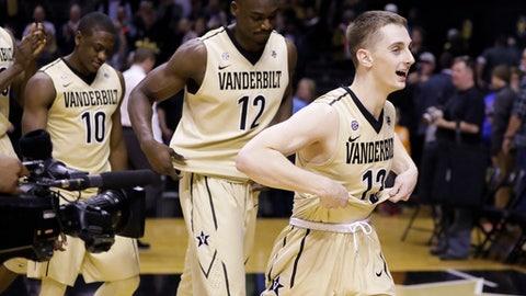 Vanderbilt's Riley LaChance (13), Djery Baptiste (12) and Maxwell Evans (10) leave the court after beating Florida in an NCAA college basketball game Saturday, Feb. 17, 2018, in Nashville, Tenn. Vanderbilt won 71-68. (AP Photo/Mark Humphrey)