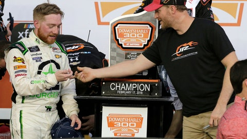 Tyler Reddick, left, is congratulated by team owner Dale Earnhardt Jr., right, in Victory Lane after winning the NASCAR Xfinity Series auto race at Daytona International Speedway in Daytona Beach, Fla., Saturday, Feb. 17, 2018. (AP Photo/Terry Renna)