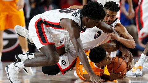 Tennessee guard Jordan Bowden (23) fight to keep position of the ball from Georgia forward Rayshaun Hammonds (20) and Georgia guard Juwan Parker (3) during the first half of an NCAA college basketball game, Saturday, Feb. 17, 2018 in Athens, Ga. (Joshua L. Jones/Athens Banner-Herald via AP)