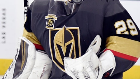 Vegas Golden Knights goaltender Marc-Andre Fleury (29) stops the puck after a shot by the Montreal Canadiens during the third period of an NHL hockey game Saturday, Feb. 17, 2018, in Las Vegas. (AP Photo/David Becker)