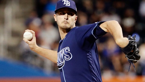 FILE - In this Sept. 11, 2017, file photo, Tampa Bay Rays' Jake Odorizzi delivers a pitch during the first inning of a baseball game against the New York Yankees in New York. The Twins have acquired Odorizzi from the Rays for minor league infielder Jermaine Palacios, securing some needed depth for their rotation. (AP Photo/Frank Franklin II, File)