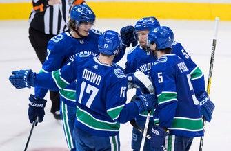 Eriksson, Nilsson lead Canucks past Bruins, 6-1