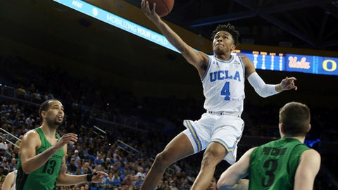 UCLA guard Jaylen Hands (4) shoots during the second half of the team's NCAA college basketball game against Oregon in Los Angeles on Saturday, Feb. 17, 2018. UCLA won in overtime, 86-78. (AP Photo/Reed Saxon)