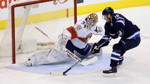 Winnipeg Jets center Bryan Little (18) loses control of the puck as he gets a clear breakaway on Florida Panthers goaltender James Reimer (34) during the first period of an NHL hockey game in Winnipeg, Manitoba, Sunday, Feb. 18, 2018. Winnipeg won, 7-2. (Trevor Hagan/The Canadian Press via AP)