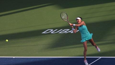 Agnieszka Radwanska of Poland returns the ball to Daria Kasatkina of Russia during the Dubai Duty Free Tennis Championship in Dubai, United Arab Emirates, Monday, Feb. 19, 2018. (AP Photo/Kamran Jebreili)