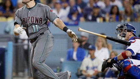 FILE - In this Oct. 6, 2017, file photo, Arizona Diamondbacks' A.J. Pollock watches his home run against the Los Angeles Dodgers during the third inning of Game 1 of baseballs National League Division Series, in Los Angeles. With J.D. Martinez apparently gone for good, the  Diamondbacks could use a big year from Pollock in what might be his last season with the team. He becomes a free agent after this year.  (AP Photo/Jae C. Hong, File)
