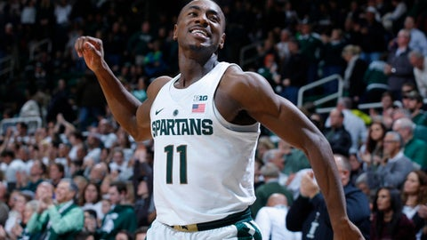 FILE - In this Dec. 30, 2016, file photo, Michigan State's Tum Tum Nairn celebrates the team's 61-52 win over Northwestern in an NCAA college basketball game, in East Lansing, Mich. No. 2 Michigan State can seal a share of the Big Ten title with a win Tuesday night against Illinois at home, where three seniors will come off the bench in their last game at the Breslin Center. (AP Photo/Al Goldis, File)
