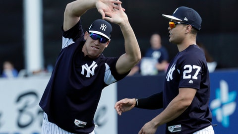 New York Yankees' Aaron Judge, left, and Giancarlo Stanton stretch at baseball spring training camp, Monday, Feb. 19, 2018, in Tampa, Fla. (AP Photo/Lynne Sladky)