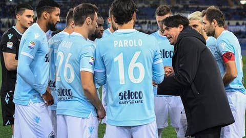 Lazio's coach Simone Inzaghi talks to his team's players prior the Italian Serie A soccer match between Lazio and Verona at the Olympic stadium in Rome, Italy, Monday, Feb. 19, 2016. (Alessandro Di Meo/ANSA via AP)