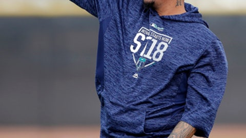 Seattle Mariners starting pitcher Felix Hernandez throws during a baseball spring training workout, Monday, Feb. 19, 2018, in Peoria, Ariz. (AP Photo/Charlie Neibergall)