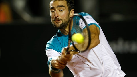 Croatia's Marin Cilic returns the ball to Argentina's Carlos Berlocq during the Rio Open tennis tournament in Rio de Janeiro, Brazil, Monday, Feb. 19, 2018. (AP Photo/Silvia Izquierdo)
