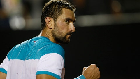 Croatia's Marin Cilic celebrates a point against Argentina's Carlos Berlocq during the Rio Open tennis tournament in Rio de Janeiro, Brazil, Monday, Feb. 19, 2018. (AP Photo/Silvia Izquierdo)
