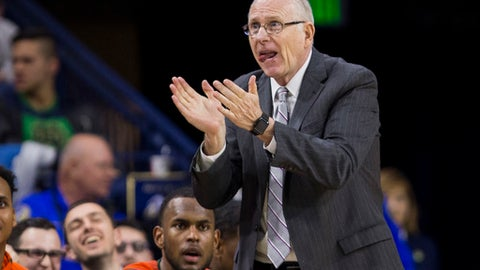 Miami head coach Jim Larraaga claps for his team during the second half of an NCAA college basketball game against Notre Dame Monday, Feb. 19, 2018, in South Bend, Ind. Miami won 77-74. (AP Photo/Robert Franklin)
