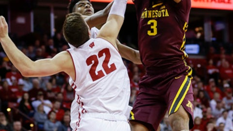 Minnesota's Jordan Murphy (3) dunks past Wisconsin's Ethan Happ (22) and Aleem Ford, behind, during the first half of an NCAA college basketball game Monday, Feb. 19, 2018, in Madison, Wis. (AP Photo/Andy Manis)