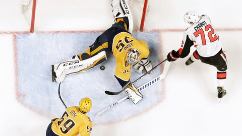 Nashville Predators goalie Pekka Rinne (35), of Finland, blocks a shot by Ottawa Senators defenseman Thomas Chabot (72) in the second period of an NHL hockey game Monday, Feb. 19, 2018, in Nashville, Tenn. (AP Photo/Mark Humphrey)