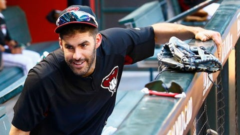 FILE - In this Oct. 2, 2017, file photo, Arizona Diamondbacks right fielder J.D. Martinez smiles as he talks with another player during practice at Chase Field for a National League wild-card playoff baseball game in Phoenix. A person familiar with the negotiations says slugger Martinez and the Boston Red Sox have agreed to a $110 million, five-year contract. The person spoke to The Associated Press on condition of anonymity Monday, Feb. 19, 2018, because the agreement was subject to a successful physical and had not been announced. (AP Photo/Ross D. Franklin, File)