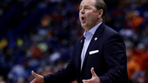 FILE - This March 20, 2016 file photo shows Middle Tennessee head coach Kermit Davis talking to his players during the first half of a second-round men's college basketball game against Syracuse in the NCAA Tournament in St. Louis. The Blue Raiders checked in at No. 24 in Monday's latest AP Top 25 for its first ranking in program history. (AP Photo/Charlie Riedel, file)