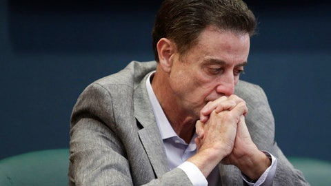 FILE - In this June 15, 2017, file photo, Louisville basketball coach Rick Pitino listens during an NCAA college basketball news conference in Louisville, Ky. Louisville must vacate its 2013 mens basketball title following an NCAA appeals panels decision to uphold sanctions against the mens program for violations committed in a sex scandal. The Cardinals will have to vacate 123 victories including the championship, and return millions in postseason revenue. The decision announced on Tuesday, Feb. 20, 2018, by the governing bodys Infraction Appeals Committee ruled that the NCAA has the authority to take away championships for what it considers major rule violations.  (Alton Strupp/The Courier-Journal via AP, File)