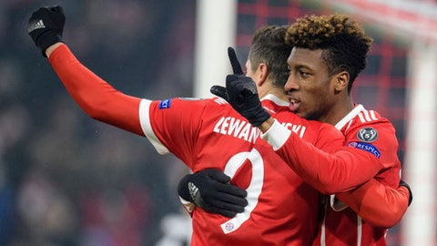 Bayern's Robert Lewandowski, left, congratulates Kingsley Coman who scored their second goal during the Champions League round of 16 first leg soccer match between Bayern Munich and Besiktas Istanbul in Munich, southern Germany, Tuesday, Feb. 20, 2018.  (Matthias Balk/dpa via AP)