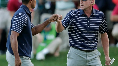 FILE - In this  Saturday, Sept. 29, 2012 file photo, USA's Tiger Woods and Steve Stricker celebrate after winning the 16th hole during a four-ball match at the Ryder Cup PGA golf tournament at the Medinah Country Club in Medinah, Ill. Woods and Stricker were selected as vice captains for the 2018 Ryder Cup. (AP Photo/Charlie Riedel, File)