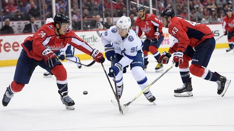 Tampa Bay Lightning center Vladislav Namestnikov (90), of Russia, battles for the puck against Washington Capitals defenseman John Carlson (74) and right wing Tom Wilson (43) during the first period of an NHL hockey game Tuesday, Feb. 20, 2018, in Washington. (AP Photo/Nick Wass)
