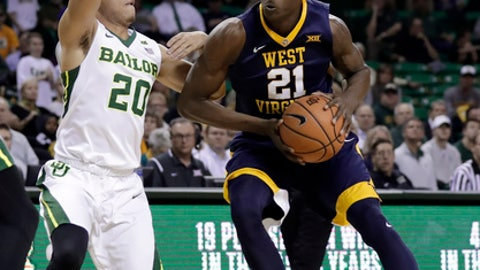 Baylor's Manu Lecomte, left, defends as West Virginia forward Wesley Harris (21) makes a move to the basket during the first half of an NCAA college basketball game Tuesday, Feb. 20, 2018, in Waco, Texas. (AP Photo/Tony Gutierrez)