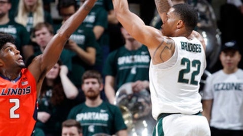 Michigan State's Miles Bridges, right, shoots a 3-pointer against Illinois' Kipper Nichols (2) during the first half of an NCAA college basketball game Tuesday, Feb. 20, 2018, in East Lansing, Mich. (AP Photo/Al Goldis)