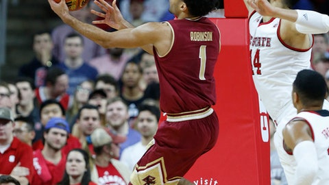 Boston College's Jerome Robinson (1) shoots as North Carolina State's Omer Yurtseven (14) defends during the first half of an NCAA college basketball game, Tuesday, Feb. 20, 2018 in Raleigh, N.C. (Ethan Hyman/The News & Observer via AP)