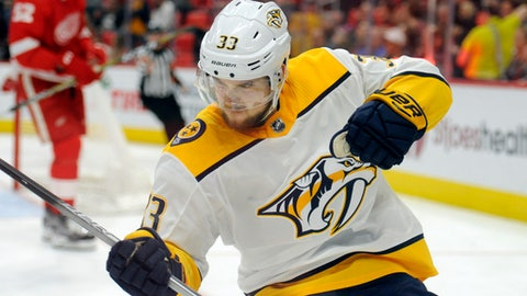 Nashville Predators left wing Viktor Arvidsson (33) reacts after scoring against the Detroit Red Wings in the third period of an NHL hockey game, Tuesday, Feb. 20, 2018, in Detroit. (AP Photo/Jose Juarez)