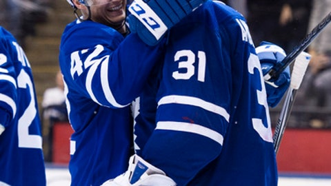 Toronto Maple Leafs center Tyler Bozak (42) congratulates goaltender Frederik Andersen (31) after defeating the Florida Panthers   in an NHL hockey game Tuesday, Feb. 20, 2018, in Toronto. (Christopher Katsarov/The Canadian Press via AP)