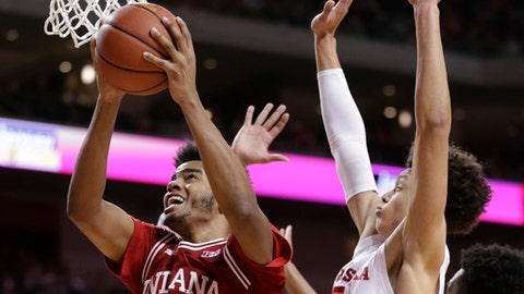 Indiana's Juwan Morgan (13) goes to the basket in front of Nebraska's Isaiah Roby during the second half of an NCAA college basketball game in Lincoln, Neb., Tuesday, Feb. 20, 2018. Nebraska won 66-57. (AP Photo/Nati Harnik)