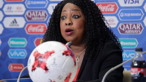 FILE - In this Friday, June 16, 2017 file photo, FIFA secretary general Fatma Samoura talks to media during a news conference at the St. Petersburg Stadium, Russia. FIFA has lifted a gag on voters publicly endorsing a 2026 World Cup bid. Soccers governing body last month ordered officials not to openly discuss the merits of either the joint Northern American bid or the rival Morocco contender. But FIFA Secretary General Fatma Samoura informed members this week of an about-turn in a letter to member associations offering new guidance on the bid rules of conduct.  (AP Photo/Dmitri Lovetsky, File)